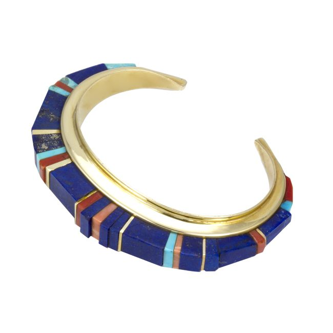 Charles Loloma (Hopi) gold bracelet with lapis, coral and turquoise. Est value $40,000.