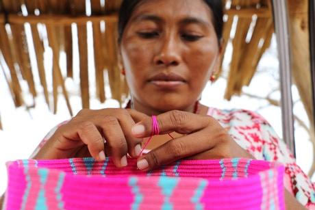 wayuu artisan woman making backpack colombia